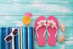 Summer Holidays. Beachwear on wooden background Royalty Free Stock Image