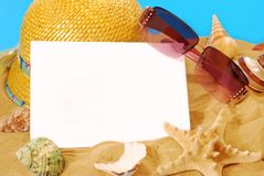 Summer holidays card. Summer holidays memories card from beach with shells,hat and sunglasses on sand Royalty Free Stock Images
