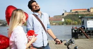 Summer holidays, celebration and dating concept - happy couple. With colorful balloons Stock Photos