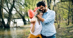 Summer holidays, celebration and dating concept - happy couple. With colorful balloons Royalty Free Stock Images