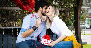 Summer holidays, celebration and dating concept - happy couple. With colorful balloons Royalty Free Stock Image