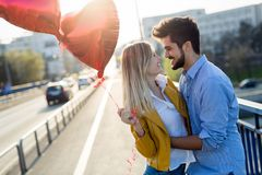 Summer holidays, celebration and dating concept - happy couple. With colorful balloons royalty free stock photos