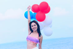 Summer holidays, celebration, happy girl with colorful balloons Royalty Free Stock Photos