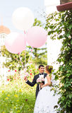 Summer holidays, celebration and wedding concept - couple with colorful balloons. And engagement ring royalty free stock images