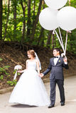 Summer holidays, celebration and wedding concept - couple with colorful balloons. And engagement ring stock photos