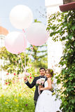 Summer holidays, celebration and wedding concept - couple with colorful balloons. And engagement ring stock images