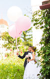 Summer holidays, celebration and wedding concept - couple with colorful balloons. And engagement ring royalty free stock photos