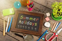 Summer holidays concept - school supplies on the wooden desk. Summer holidays concept school supplies on the wooden desk royalty free stock images