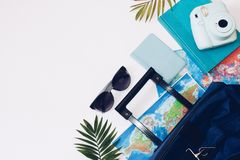 Summer holidays concept.  Travel, tourism and vacation concept background. Traveler accessories. Flat lay. Blue suitcase with trav. Travel bag and straw hat stock photos