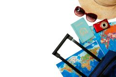 Summer holidays concept.  Travel, tourism and vacation concept background. Traveler accessories. Flat lay. Blue suitcase with trav. Travel bag and straw hat stock image