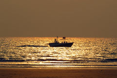 Summer Holidays Fishing. A group of people fishing in the evening in the sea during summer holidays Stock Photography