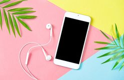 Summer holidays flat lay Mobile phone headphones Royalty Free Stock Images