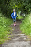 Summer holidays, girl running in the woods Royalty Free Stock Images