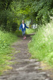 Summer holidays, girl running in the woods Royalty Free Stock Photo