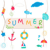 Summer holidays. Hanging summer beach products and blank photo.  Stock Photo