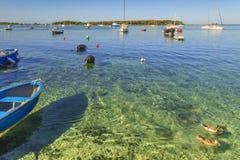 Summer holidays.Ionian coast of Salento:Porto Cesareo Lecce.- ITALY Apulia -In the background  the Big Island or Isola Grande Stock Image