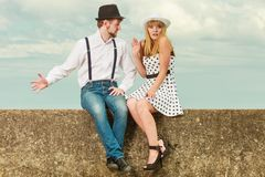 Loving couple retro style dating on sea coast. Summer holidays love relationship and dating concept - romantic playful couple retro style flirting on sea shore royalty free stock photo