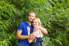 Summer holidays, love, romance and people concept - happy smiling young couple hugging outdoors Royalty Free Stock Photography