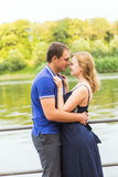 Summer holidays, love, romance and people concept - happy smiling young couple hugging outdoors Stock Photo