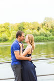 Summer holidays, love, romance and people concept - happy smiling young couple hugging outdoors Royalty Free Stock Image