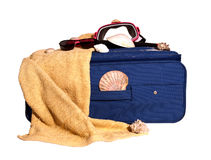 Summer Holidays Luggage. Consisting of a blue suitcase, towel, seashells and a snorkeling kit Royalty Free Stock Images