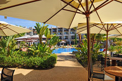 Summer holidays, magnificent swimming pool , Andalusia, Spain. Terrace with parasols a the pool of a resort in Huelva, Andalusia, Spain Stock Images