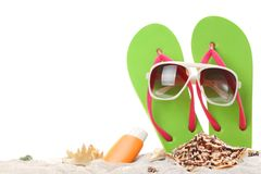 Summer holidays memories from beach. With shells and sunglasses on sand Stock Images