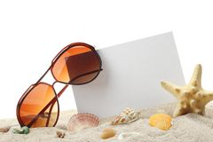 Summer holidays memories from beach. Summer holidays memories card from beach with shells and sunglasses on sand Royalty Free Stock Photo