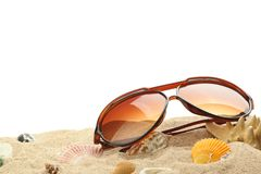 Summer holidays memories from beach. With shells and sunglasses on sand Stock Photo