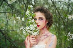 Summer holidays. Natural beauty and spa therapy. Summer girl at blooming tree. face and skincare. womens health. allergy. To flowers. Springtime. weather royalty free stock photo
