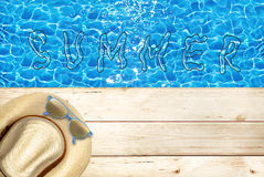 Summer holidays and relax. Starfish on sand, wooden floor, summer vacations shells, water type Royalty Free Stock Photos
