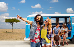 Happy hippie couples and minivan in africa Royalty Free Stock Image