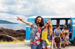 Happy hippie couples and minivan on island Royalty Free Stock Photo