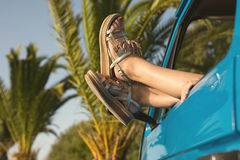Summer Holidays. Road trip, travel and people concept, young woman resting in minivan car Stock Images