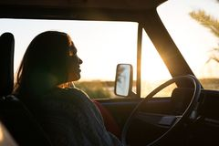 At Last! Summer Holidays!. Summer holidays, road trip, travel and people concept, young woman resting in minivan car royalty free stock photos