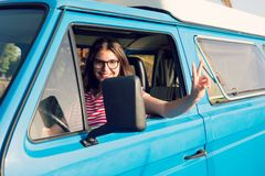 Summer Holidays. Road trip, travel and people concept, young woman resting in minivan car royalty free stock photo
