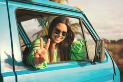Summer Holidays. Road trip, travel and people concept, young woman resting in minivan car Royalty Free Stock Images