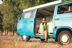 Summer Holidays. Road trip, travel and people concept, young woman resting in minivan car Stock Image