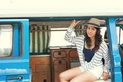 Summer Holidays. Road trip, travel and people concept, young woman resting in minivan car Stock Photography