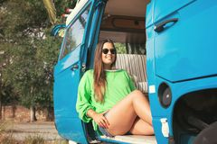 Summer Holidays. Road trip, travel and people concept, young woman resting in minivan car Stock Photo