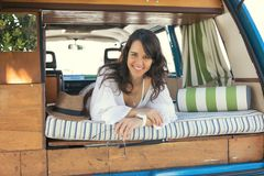 Summer Holidays. Road trip, travel and people concept, young woman resting in minivan car Royalty Free Stock Image