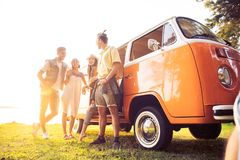 Free Summer Holidays, Road Trip, Vacation, Travel And People Concept - Smiling Young Hippie Friends Having Fun Over Minivan Stock Photography - 128791272