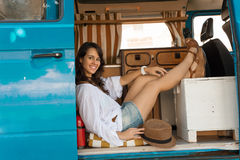 Summer holidays. Road trip, vacation, travel and people concept - smiling young hippie woman in car Royalty Free Stock Photography