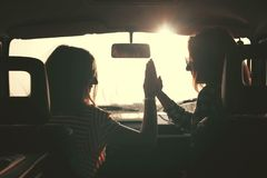 Summer Road-Trip. Summer holidays, road trip, vacation, travel and people concept - smiling young hippie women in car stock photography