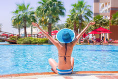 Summer holidays at the swimming pool. Happy woman on summer holidays at the swimming pool stock photo