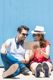 Summer holidays, teenage and technology concept - teenagers look Royalty Free Stock Images