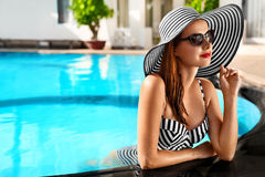 Summer Holidays. Travel Vacation. Beautiful Woman At Swimming Po. Summer Holidays. Travel Vacation To Spa Resort. Beautiful Fashionable Healthy Young Woman With royalty free stock images