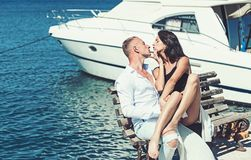 Summer holidays and travel vacation. Family and valentines day. Love relations of couple enjoying summer day together. Sexy women and men at sea bay. Couple in royalty free stock photography