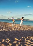 Summer holidays and travel vacation. Love relations of dancing couple enjoying summer day together. Couple in love dance. On beach sand. Family and valentines stock photography