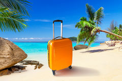 Summer holidays on the tropical beach. Summer holidays with baggages on the tropical beach Royalty Free Stock Image